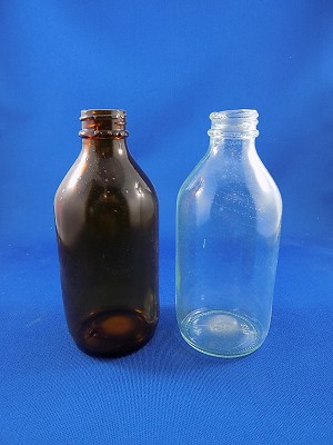"Medicine Bottle - Clear & Brown - 4 3/4"" Tall"